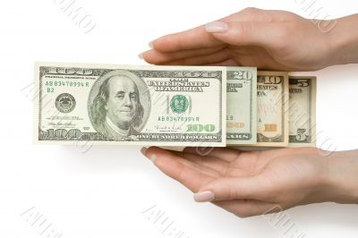 US Dollars in ladder in woman`s hand, isolated with clipping pat