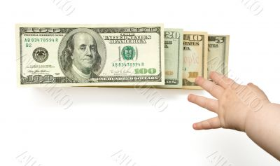Child`s hand reaching US dollars in ladder, isolated with clippi
