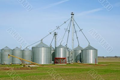 Grain silos on a farm in spring