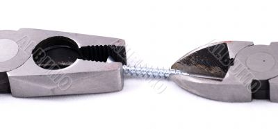 Pliers and cutter handling a screw