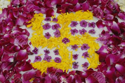 Rose petals swastika rangoli decoration Ikebana