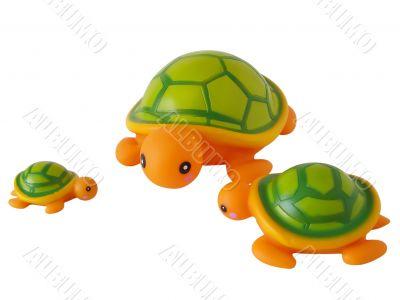 Three toy turtles stand around