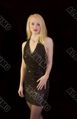 Blond in black dress standing