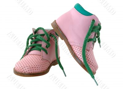 Pink leather baby`s boots.