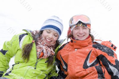 lifestyle image of two young a snowboarders