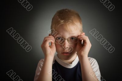 Boy try on a glasses