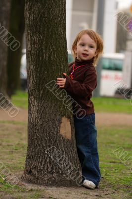 Small beauty girl playing hide-and-seek