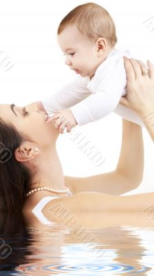 happy mother with baby boy in water 2