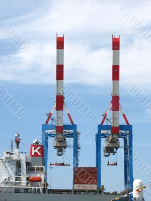 container ship in a dock with  crane
