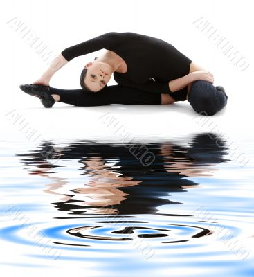 fitness in black leotard on white sand #3