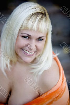 beautiful busty blonde smiling