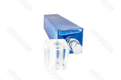 Perfume in deep blue scent-bottle.