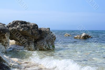 Sea tide and a rock