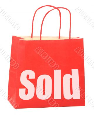 bag with white sold sign