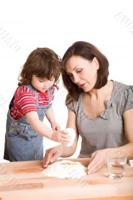 mother and daughter in the kitchen making a dough