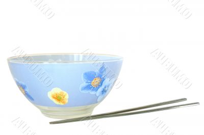 Blue cup and two steel chopsticks.