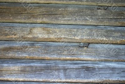 A piece of rough wooden uncolored shed wall