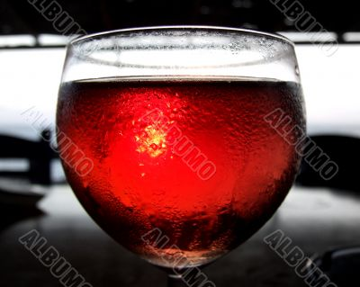 Sunlight filtering through red wine
