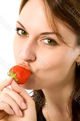 beautiful girl eating a strawberry