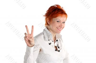 Happy lucky young woman with Victory gesture