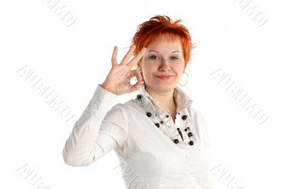 Happy lucky young woman with ok gesture