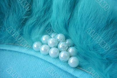 beads in fur on sweater