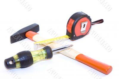 Tape-measure, hammer, screwdriver