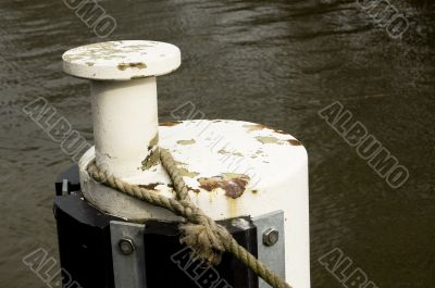 Iron bollard with ship ropes