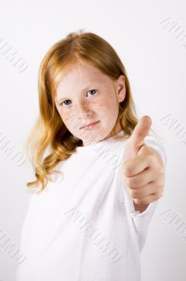 cute little girl with thumb up (focus on face )