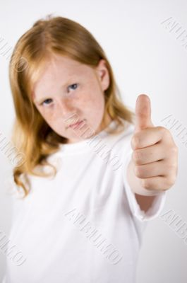 cute little girl with thumb up (focus on thumb)