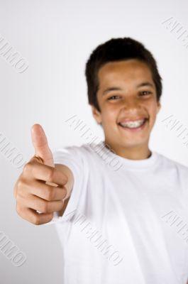 teenage boy with thumb up (focus on thumb)