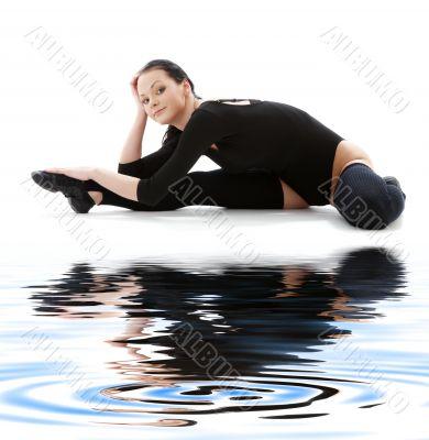 fitness in black leotard on white sand 5