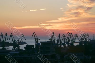 Shipyard cranes in the sunset time