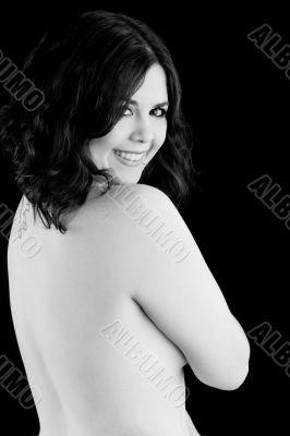 cute nude girl smiling over shoulder