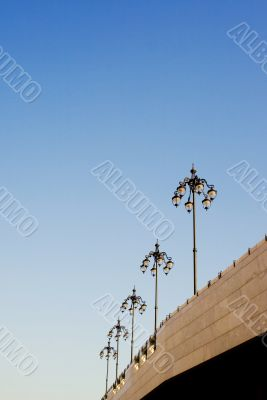 Several lamp posts on sky background