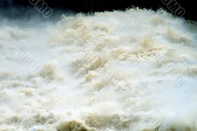 Water under a dam of hydroelectric power station