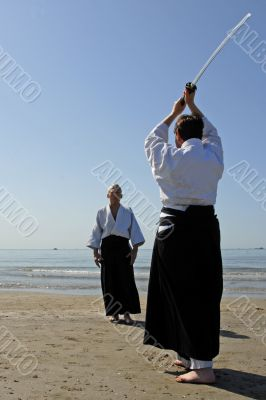 training of Aikido on the beach