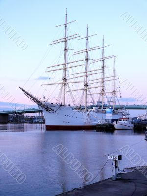 sail ship in the harbour in beautiful sunset