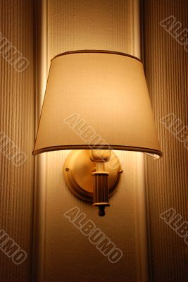 Bright lamp on hotel wall