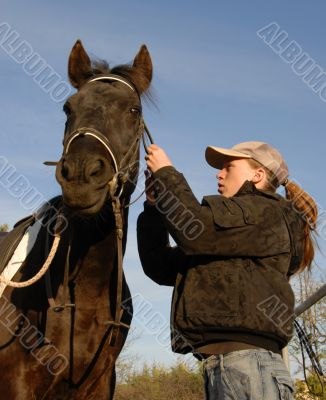 teenager, bridle and horse