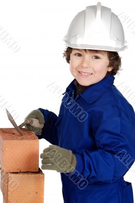 Child builder making a wall of bricks