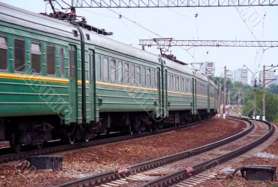 Cars of passing by passenger electric train
