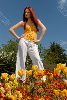 Cute young lady in in gardens