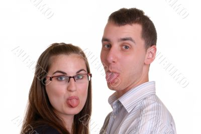 attractive young couple poke tongues out