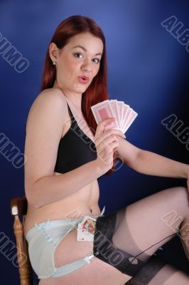 fifties cheesecake girl with playing cards