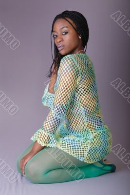 attractive young African girl in green