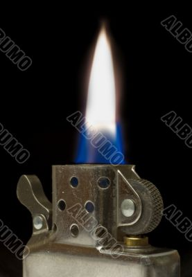 Flame of cigarette lighter on black background. Shallow DOF.