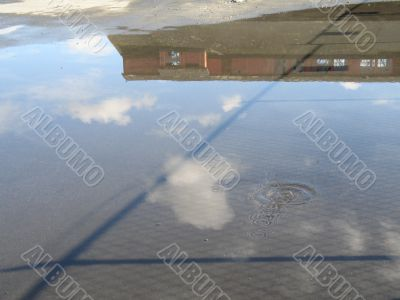 barn reflection in a puddle