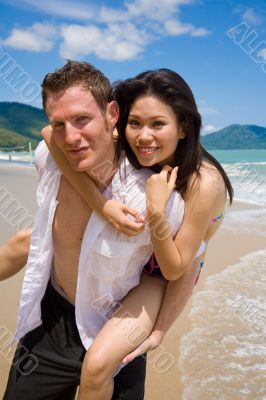 playful couple at the beach