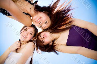 friends gather around happily under bright blue sky